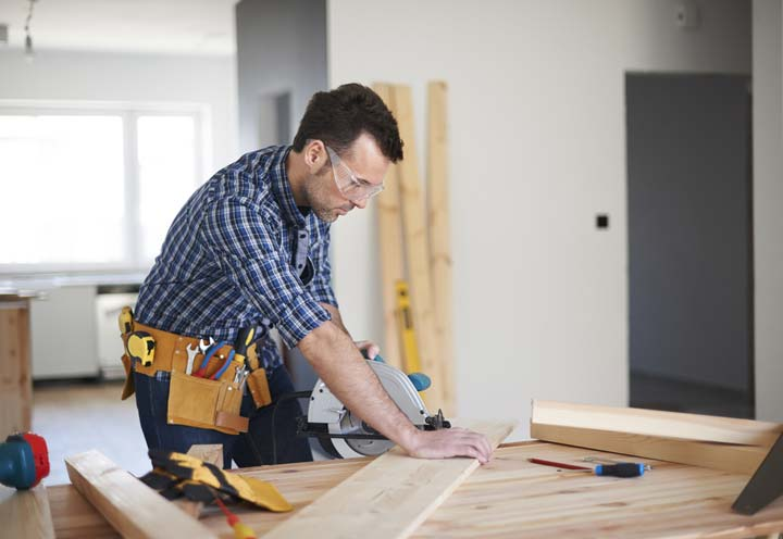 Carpenter working inside a new home | Business / Commercial Insurance
